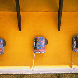 callbox-phones-yellow-wall-payphones-photo