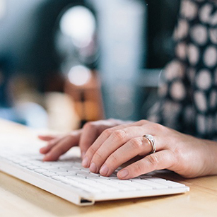 stock-photo-woman-typing-keyboard-desk-writing