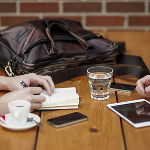 people-interviewing-ipads-iphone-handbag-table-photo